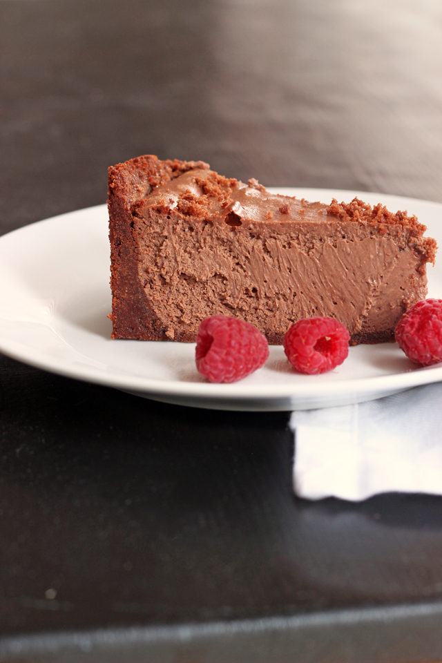 A piece of chocolate cheesecake on a plate