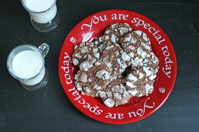 A plate of cookies with glasses of milk