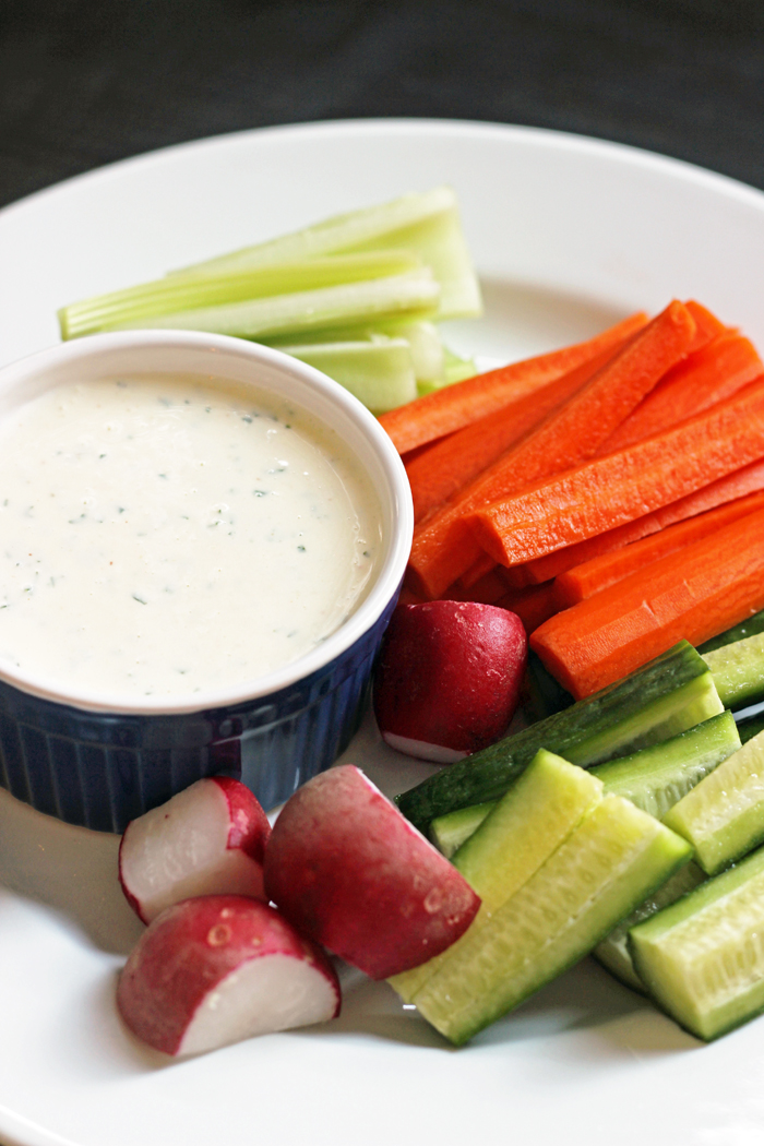 A plate of veggies with Ranch dressing