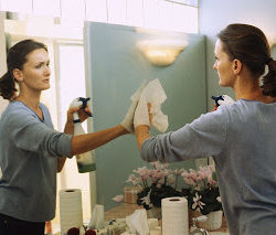 Woman Cleaning Mirror ca. 1999
