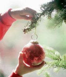 Child Decorating a Christmas Tree