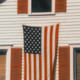 American Flag Hanging on a House
