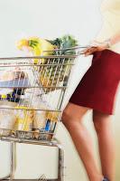Woman Pushing Shopping Cart ca. 2002