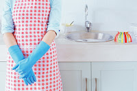 Woman by the kitchen sink --- Image by © Royalty-Free/Corbis