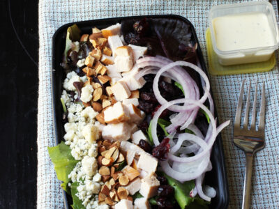 salad of greens with turkey, fruit, and cheese