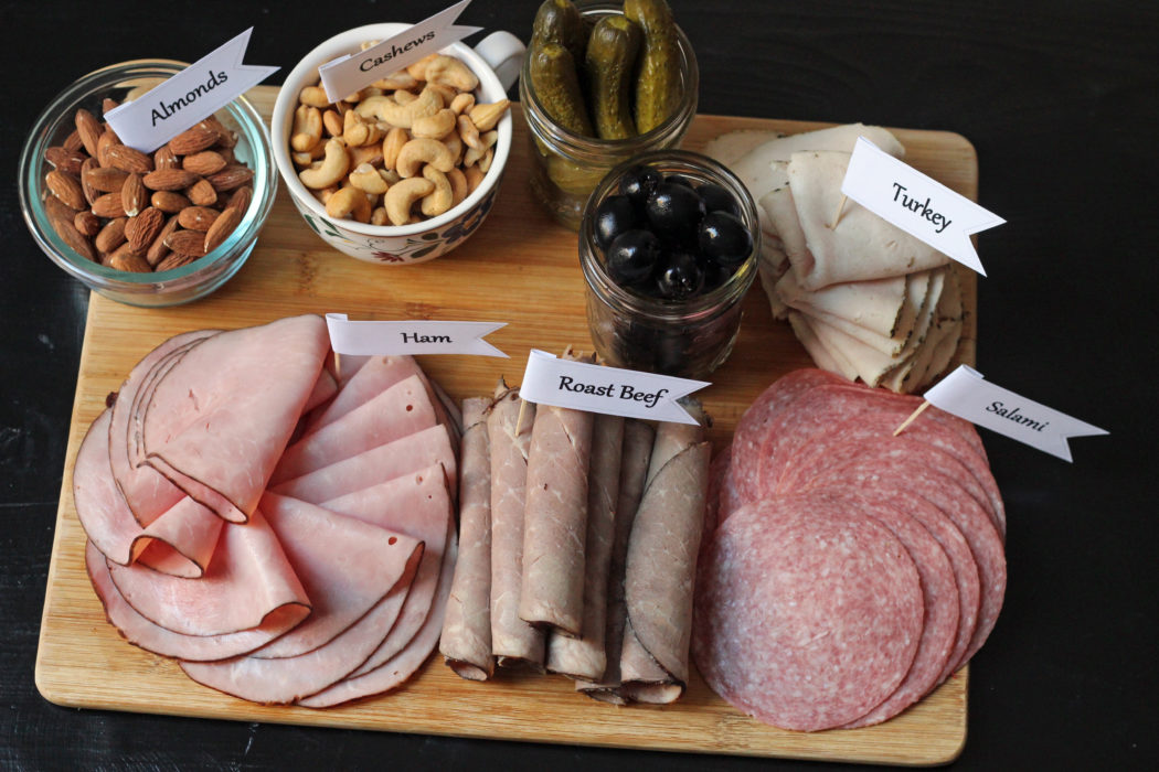 A bunch of foods on a Charcuterie Tray