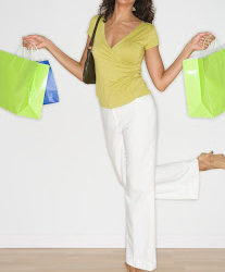 Young Woman with Shopping Bags --- Image by © Royalty-Free/Corbis
