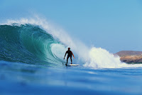 Surfer on a Wave --- Image by © Royalty-Free/Corbis