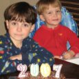 boys in pajamas with New Year's Cake