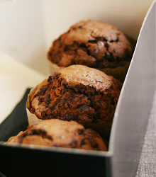 Three muffins in a box --- Image by © Royalty-Free/Corbis