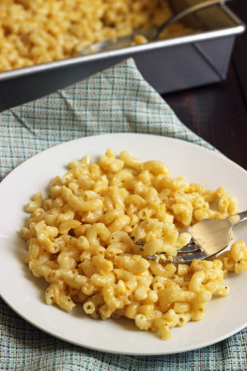 plate of macaroni and cheese on a plaid napkin