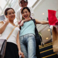 Shoppers Riding Escalator --- Image by © Royalty-Free/Corbis