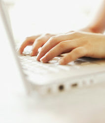 Hands of Woman Using Laptop Computer --- Image by © Royalty-Free/Corbis