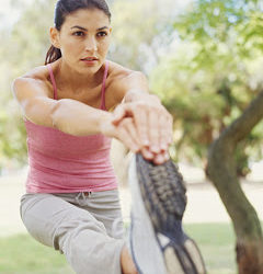 young woman exercising in a park --- Image by © Royalty-Free/Corbis