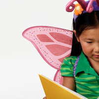 Young Girl Reading --- Image by © Royalty-Free/Corbis