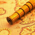 ca. 2000 --- Spyglass on a Map --- Image by © Royalty-Free/Corbis