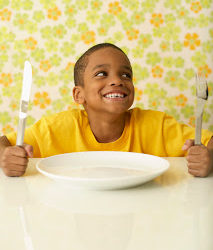 Hungry Boy at the Table --- Image by © Royalty-Free/Corbis