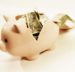 Broken piggy bank --- Image by © Royalty-Free/Corbis
