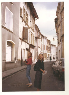 two girls walking down a French street