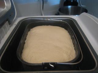 baguette dough rising in bread machine pan