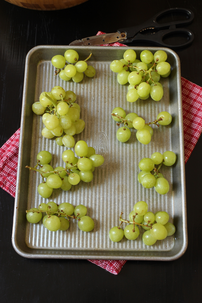 grape clusters on baking sheet