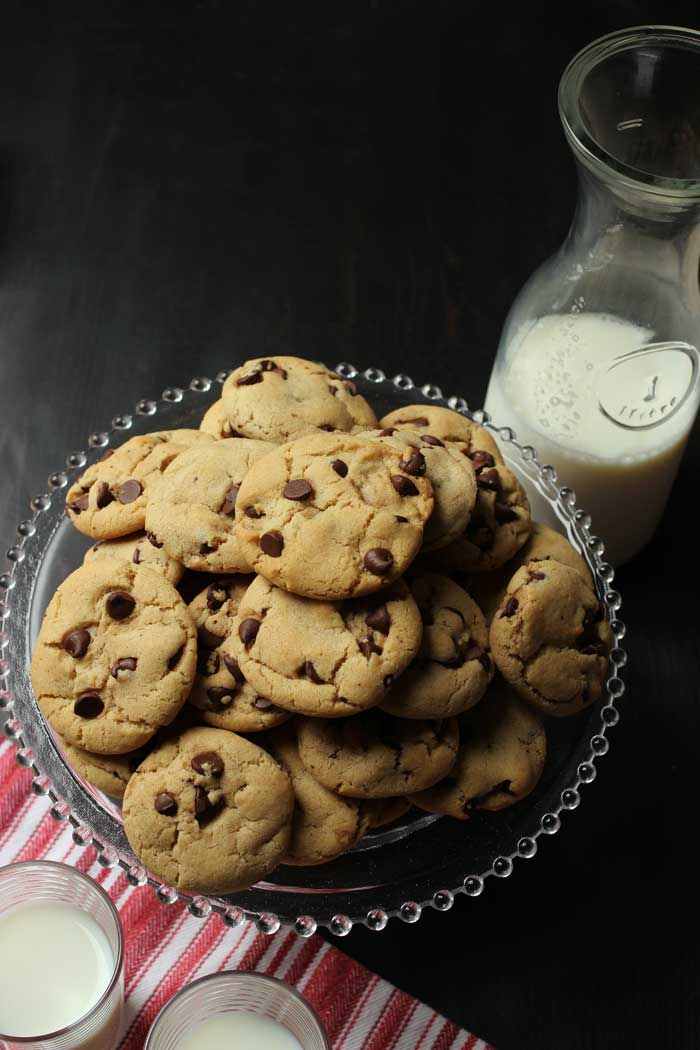 carafe and glasses of milk with tray of cookies