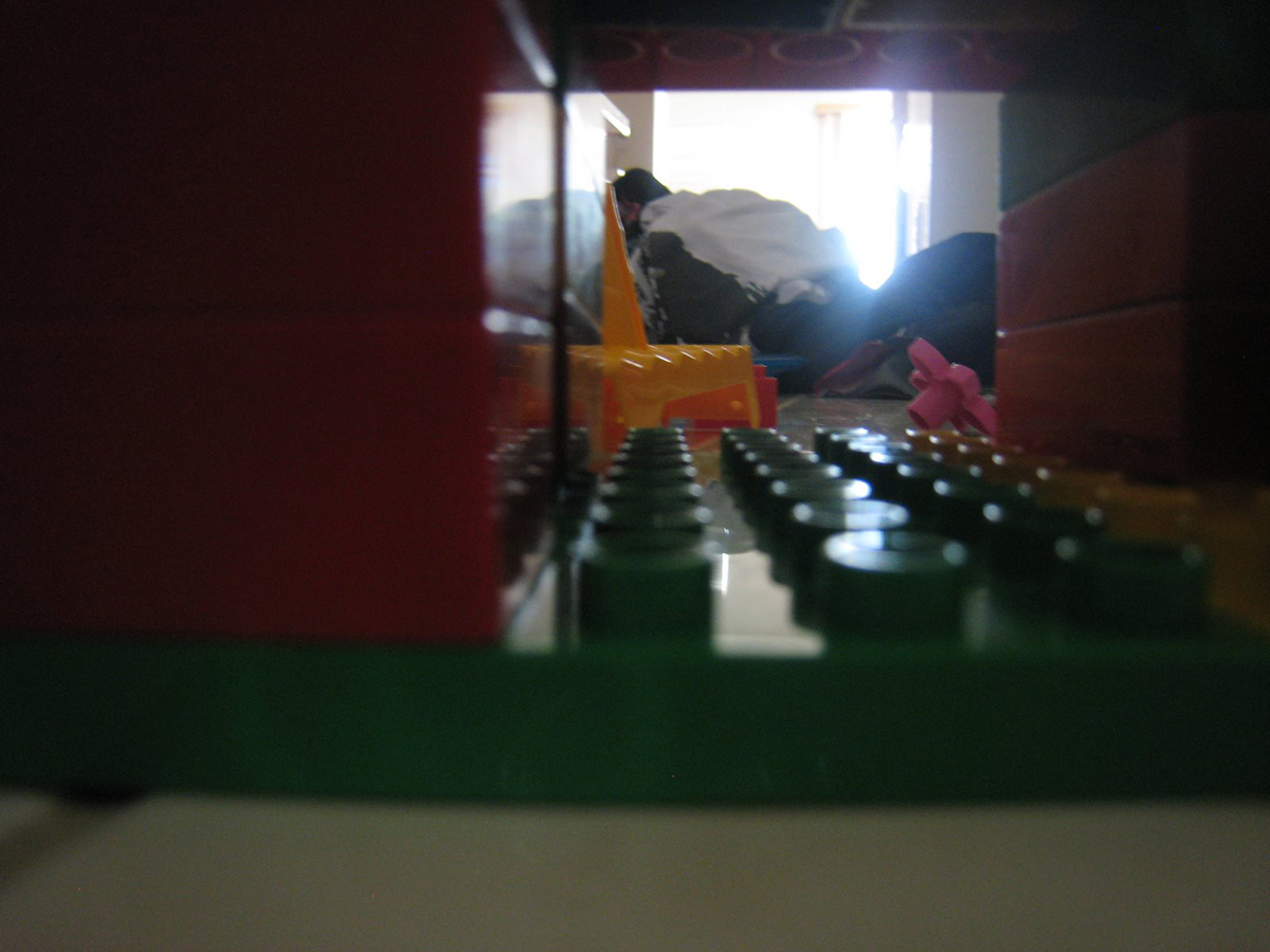 blurry photo of duplo creation next to pile of laundry