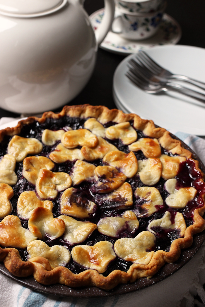 Blueberry Pie with tea pot, cups, plates and forks