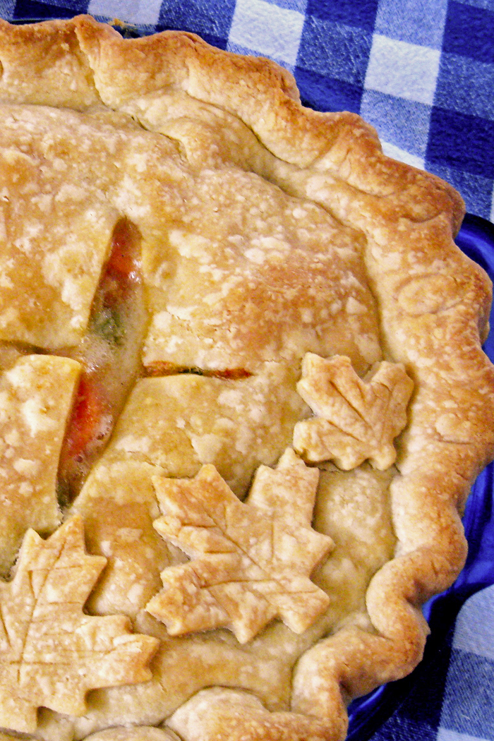 Chicken Pot Pie | Life as Mom - Chicken Pot Pie is a sure-fire favorite at my house. Flaky, buttery crust surrounds chicken, vegetables, and a delectable homemade gravy for delicious comfort food.