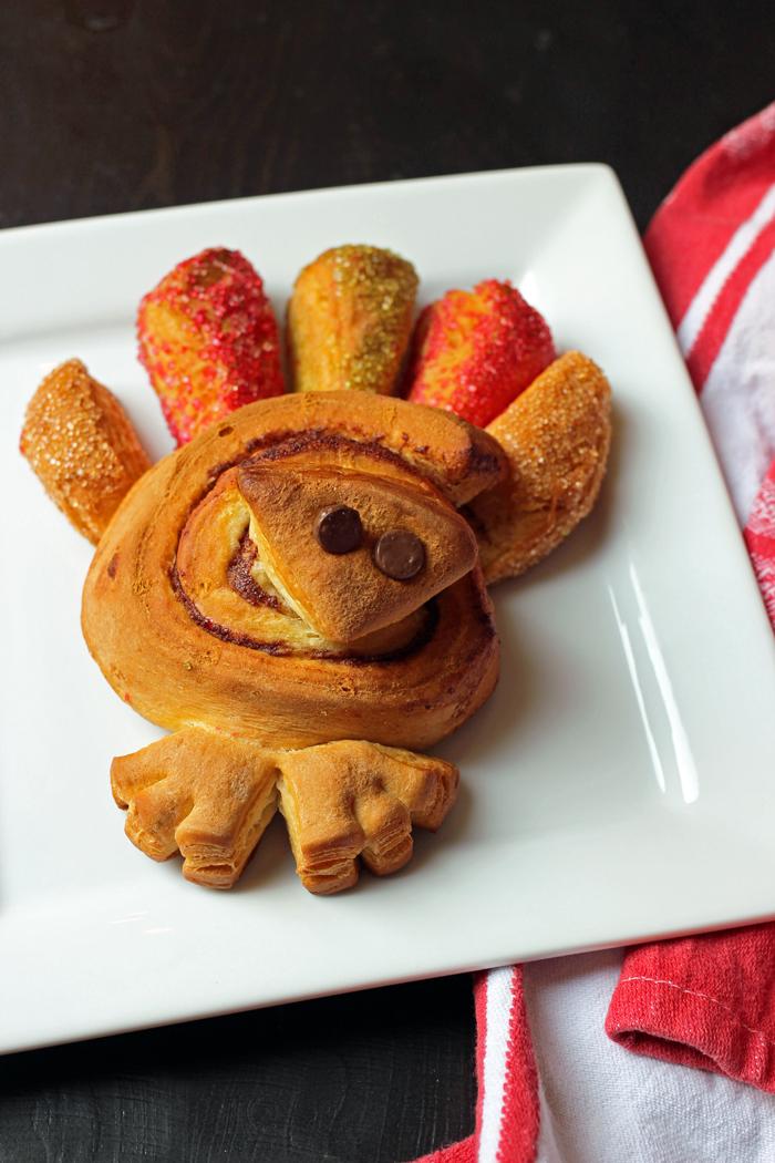 baked cinnamon roll turkey on plate