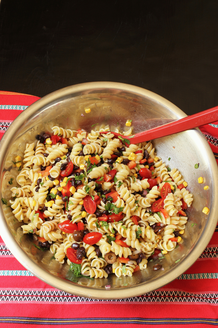 bowl of southwest pasta salad with red spoon