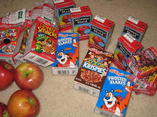 juice boxes, cereal, and apples