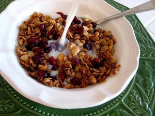 bowl of cranberry orange granola and milk