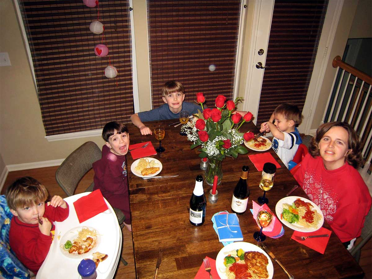 boys and mom sitting at Valentine's dinner