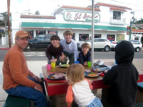 A family at a table in front of El Indio