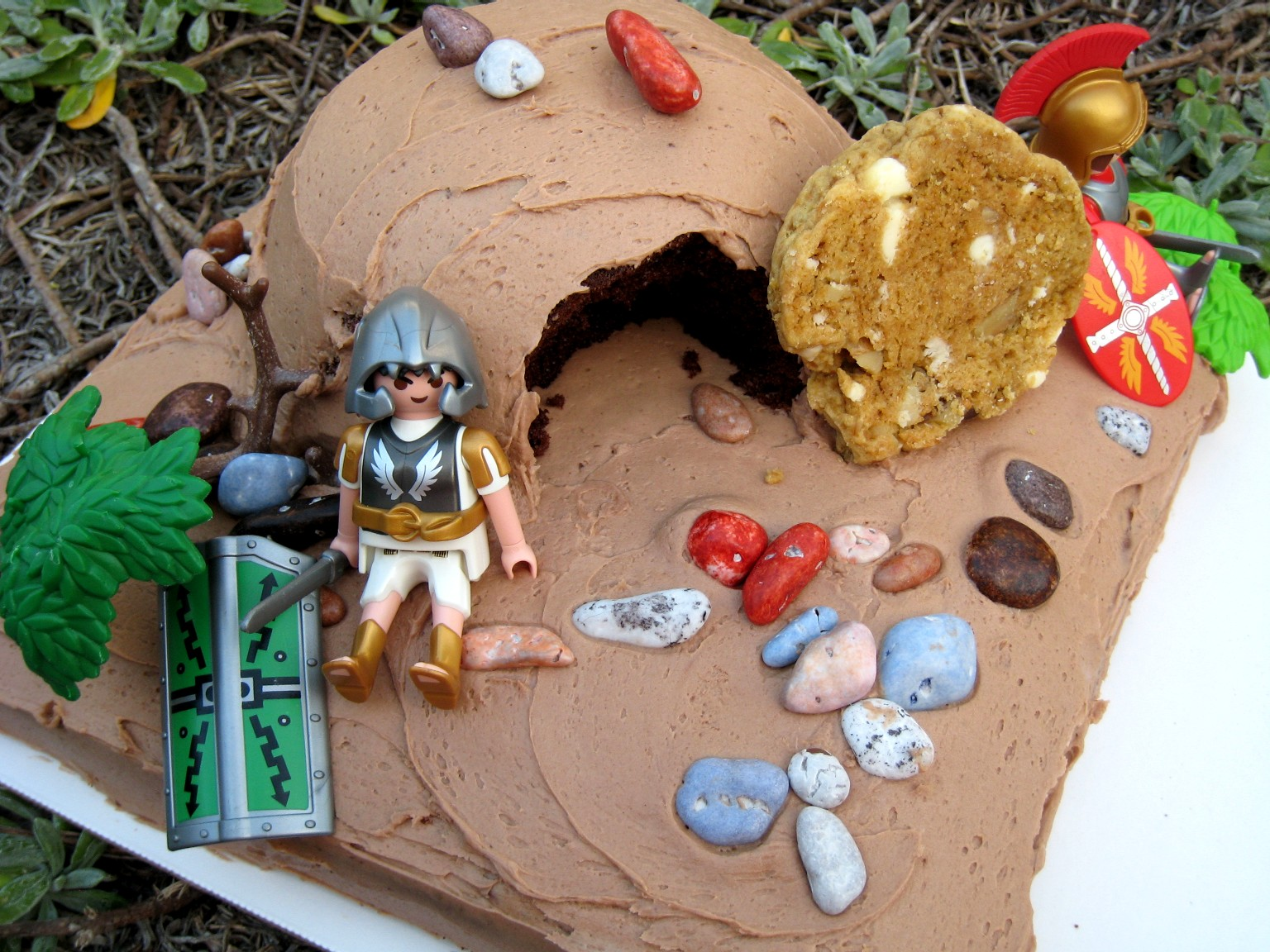 decorated empty tomb cake with candy rocks and plastic soldiers