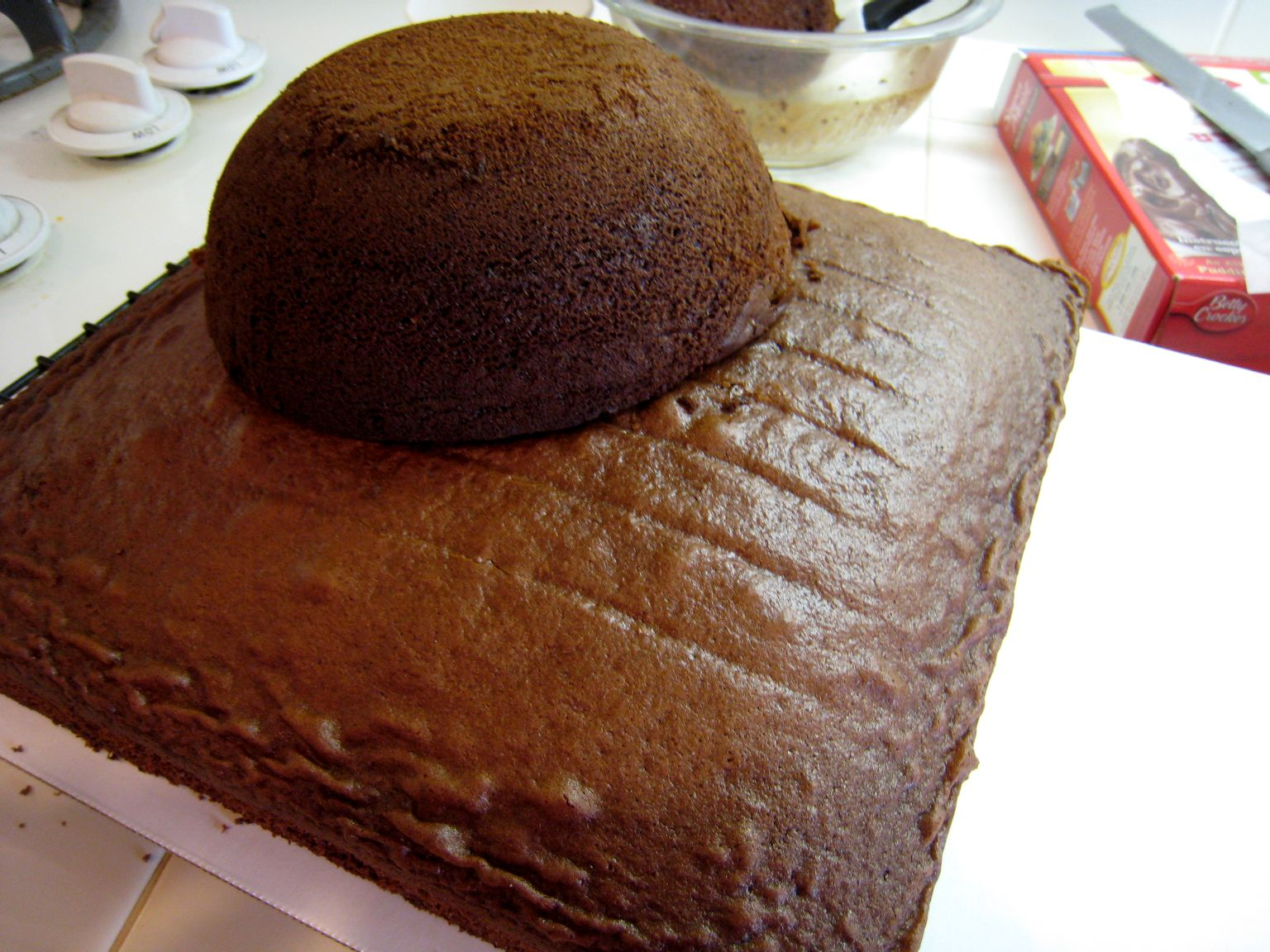 round cake stacked on square cake