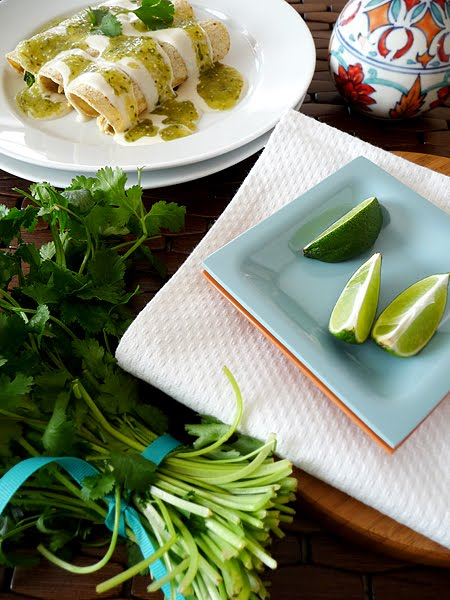 table set with enchilada platter
