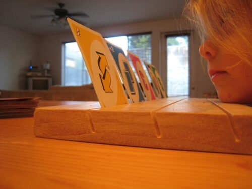Card games are fun to play with kids. Make this card holding board so that little hands don't get frustrated.