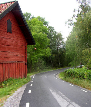 Red Barn by the Road Per Ola Wiberg
