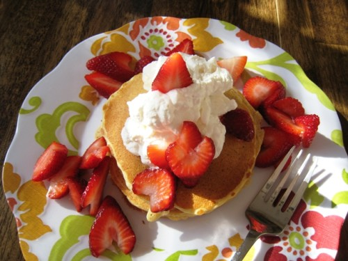 pancake stack with whipped cream and berries