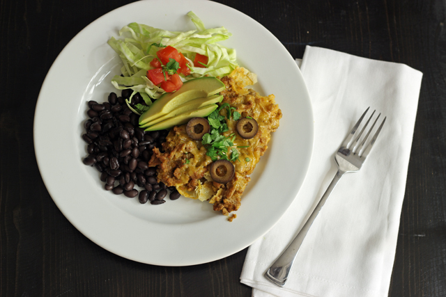 plate of taco casserole with beans and salad