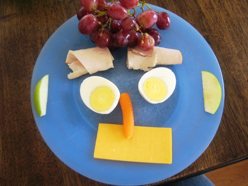 Snacky Lunch like a smiley face on a blue plate