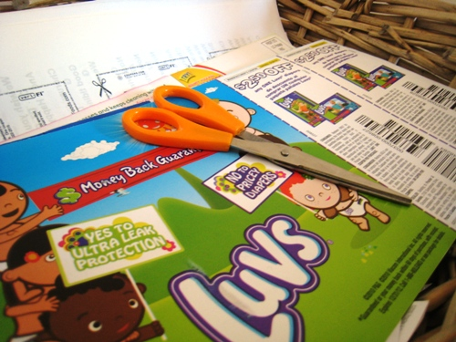 A close up of coupons and scissors