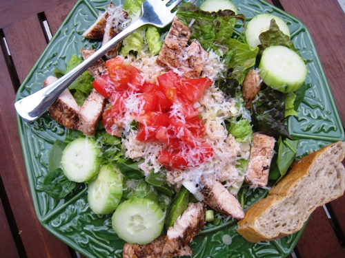 A plate of salad with fork