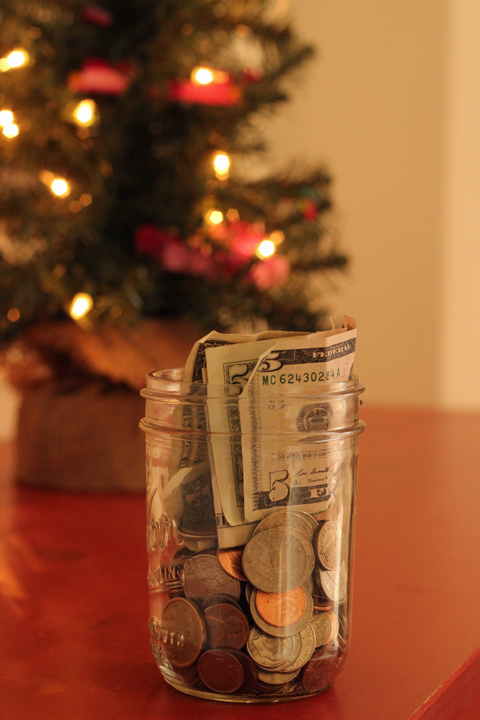 christmas tree with lights and jar of money