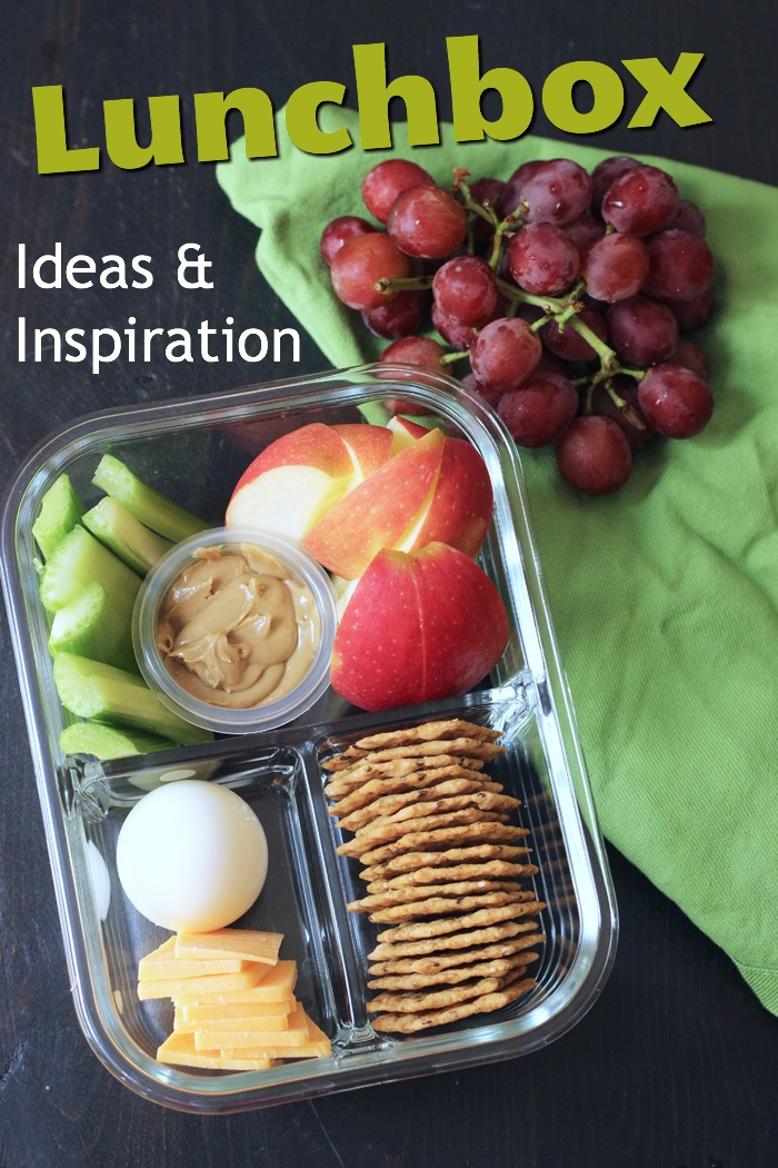 apples, grapes, and other snack elements in glass dish