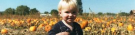 Fall boy in pumpkin patch