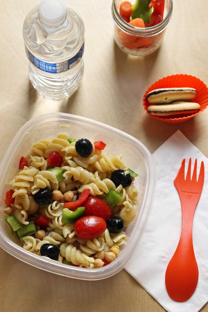 lunch of pasta salad, cookies, and vegetables