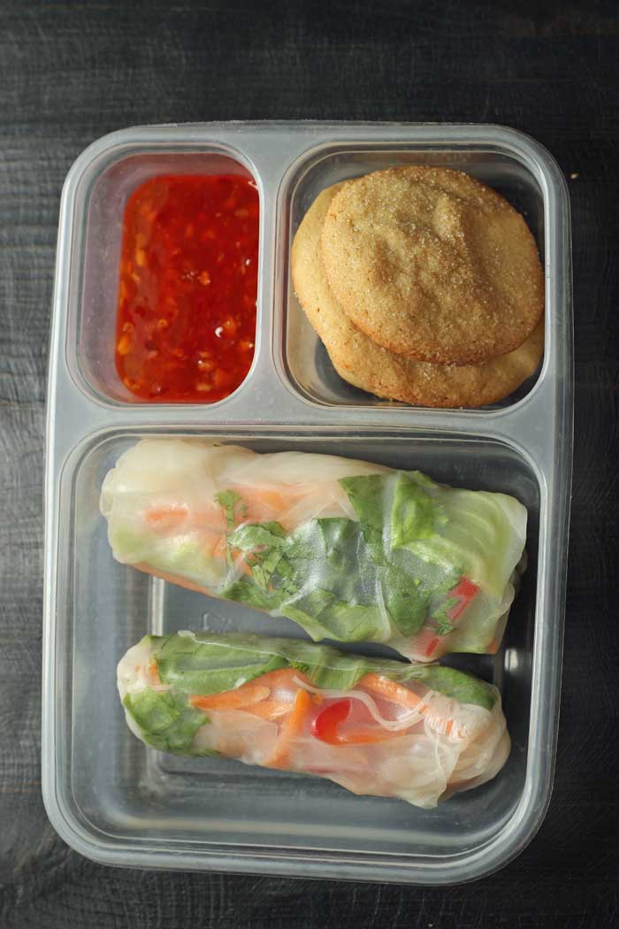 packed lunch of summer rolls cookies and dipping sauce